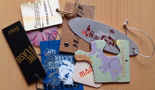 Product hang tags and swingers for clothing